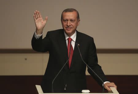 Turkey's PM Erdogan greets his party members during a meeting at the AK Party headquarters in Ankara
