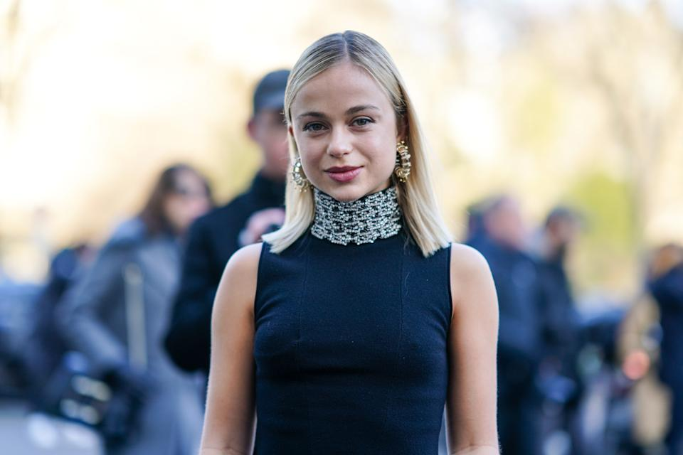 PARIS, FRANCE - JANUARY 20: Lady Amelia Windsor wears earrings, a navy-blue sleeveless turtleneck with a bejeweled collar, outside Schiaparelli, during Paris Fashion Week - Haute Couture Spring/Summer 2020, on January 20, 2020 in Paris, France. (Photo by Edward Berthelot/Getty Images )