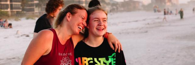 photo of contributor cindy johnson and daughter standing on beach smiling and laughing