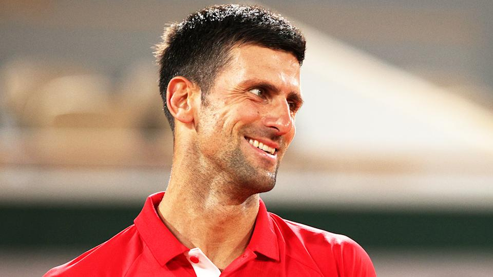 Novak Djokovic (pictured) smiling after a point at the French Open First Round.