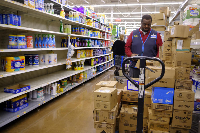 BLOOMINGTON, UNITED STATES - MARCH 11, 2020: A Wal Mart worker restocks shelves after some were emptied by panic buyers on the day World Health Organization declared Coronavirus to be a pandemic. Toilet paper, wipes, protective breathing masks, and other items are either sold out at local stores, or are in short supply.- PHOTOGRAPH BY Jeremy Hogan / Echoes Wire/ Barcroft Studios / Future Publishing (Photo credit should read Jeremy Hogan / Echoes Wire/Barcroft Media via Getty Images)