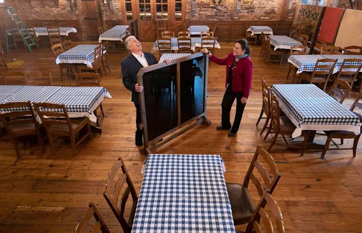 Van Eure and Steve Thanhauser, owners of the Angus Barn, set up one of their dining rooms in anticipation of re-opening in Phase Two of Gov. Roy Cooper's plan to lift coronavirus restrictions on Tuesday, May 19, 2020 in Raleigh, N.C.. The Angus Barn has reduced their seating by half, and have installed moveable partitions to help separate dining tables and make customers feel comfortable dining inside again.