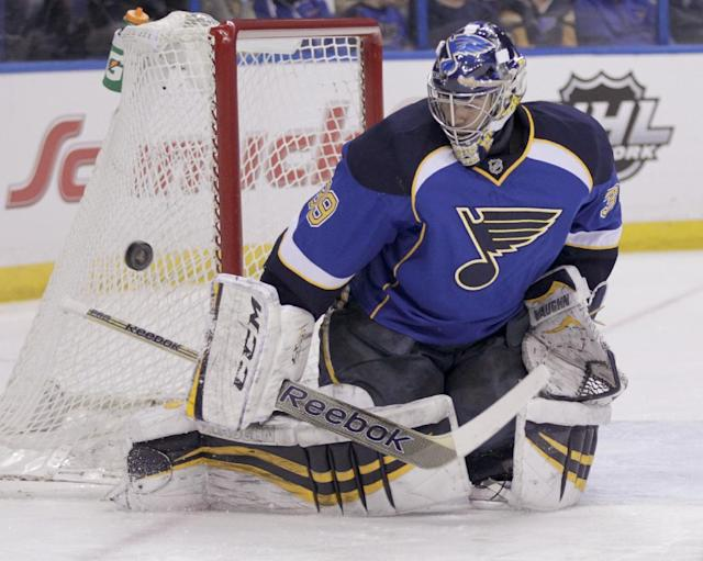 St. Louis Blues goalie Ryan Miller (39) makes a stick save during the first period of an NHL hockey game against the Washington Capitals, Tuesday, April 8, 2014, in St. Louis.(AP Photo/Tom Gannam)