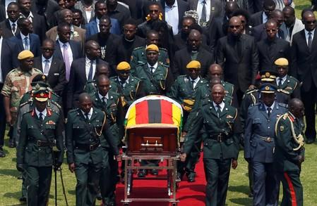Mugabe is brought to the national sports stadium for a state funeral in Harare