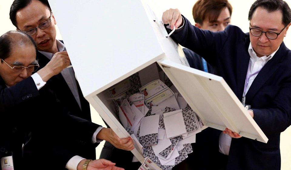 Officials open a ballot box at a polling station in Kowloon Tong, in November 2019. Photo: Reuters