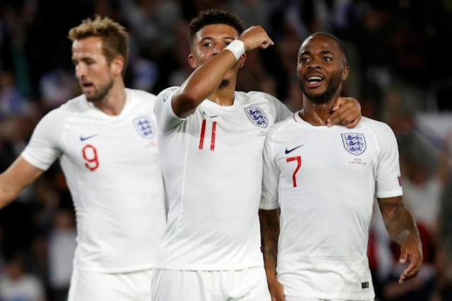 Talented trio: Harry Kane (left), Jadon Sancho (centre) and Raheem Sterling (right) have scored 14 goals in four Euro 2020 qualifiers (AFP Photo/Adrian DENNIS)