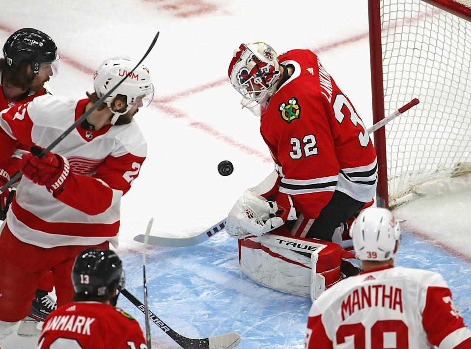 Kevin Lankinen of the Chicago Blackhawks makes a save against the Detroit Red Wings at the United Center on Jan. 22, 2021 in Chicago.