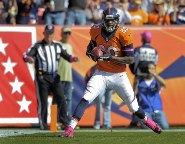 Denver Broncos tight end Julius Thomas (80) catches a touchdown pass from Peyton Manning against the Jacksonville Jaguars in the first quarter of an NFL football game, Sunday, Oct. 13, 2013, in Denver. (AP Photo/Jack Dempsey)