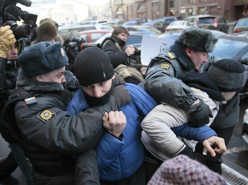 """Police detain supporters of a bill banning """"homosexual propaganda"""" near the State Duma, Russia's lower parliament chamber, in Moscow, Russia, Friday, Jan. 25, 2013. A controversial bill banning """"homosexual propaganda"""" has been submitted to Russia's lower house of parliament for the first of three hearings on Friday. Twenty people were detained according to a police report. (AP Photo/Mikhail Metzel)"""