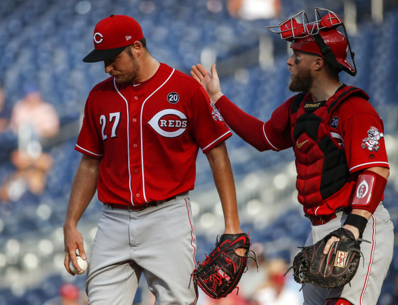 Cincinnati Reds starting pitcher Trevor Bauer (27) and catcher Tucker Barnhart talk during the fifth inning of a baseball game against the Washington Nationals at Nationals Park, Wednesday, Aug. 14, 2019, in Washington. (AP Photo/Alex Brandon)