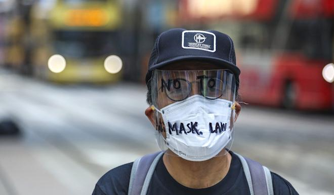 Beijing's top office on Hong Kong affairs issued a stern statement supporting the anti-mask law, citing violence in the city on the 70th anniversary of Communist Party rule. Photo: Felix Wong