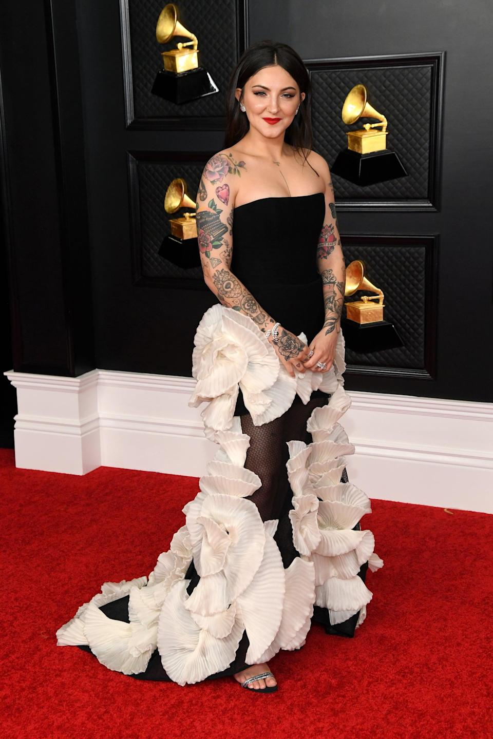 <p>Wearing a Georges Chakra Couture dress with Giuseppe Zanotti shoes and Messika jewels.</p>