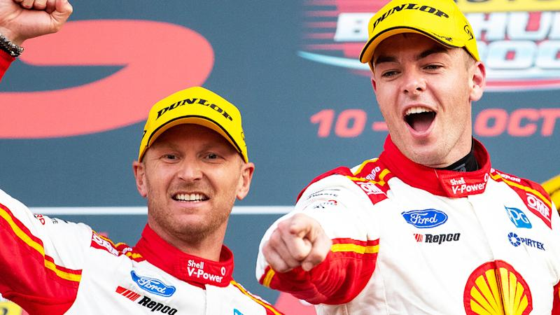 Alex Premat and Scott McLaughlin are pictured on the podium after winning the 2019 Bathurst 1000.