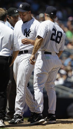 New York Yankees' Andy Pettitte leaves the game with an injury during the fifth inning of a baseball game against the Cleveland Indians Wednesday, June 27, 2012, in New York. (AP Photo/Frank Franklin II)