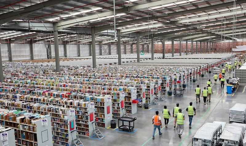Workers and shelving in Amazon fulfillment centre in Dandenong, Victoria on Wednesday, August 15, 2018.