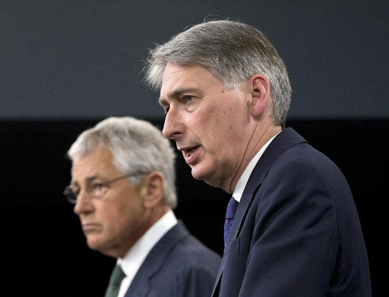 Defense Secretary Chuck Hagel and British Defense Secretary Philip Hammond participate in a  joint news conference at the Pentagon, Thursday, May 2, 2013, where the talked about Syria.  (AP Photo/J. Scott Applewhite)