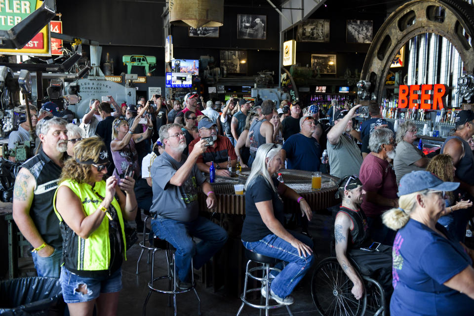 STURGIS, SD - AUGUST 09: People watch a concert at the Full Throttle Saloon during the 80th Annual Sturgis Motorcycle Rally in Sturgis, South Dakota on August 9, 2020. While the rally usually attracts around 500,000 people, officials estimate that more than 250,000 people may still show up to this year's festival despite the coronavirus pandemic. (Photo by Michael Ciaglo/Getty Images)