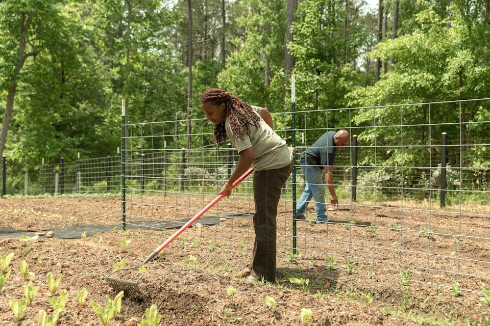 Keisha and Warren tend to their garden at their home. (Photo: Lynsey Weatherspoon for HuffPost)