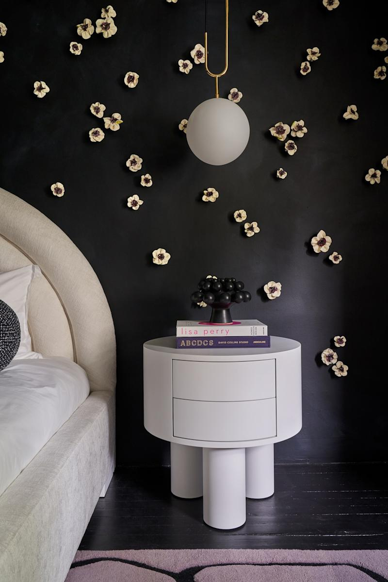 The cute nightstands are by New Day Woodwork, and the bold pendant lights are by Current Collection.