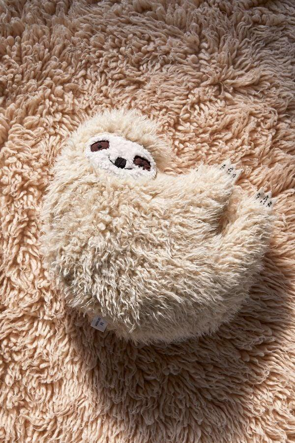 <p>Who wouldn't want to snuggle up with this <span>Furry Sloth Pillow</span> ($49)?</p>