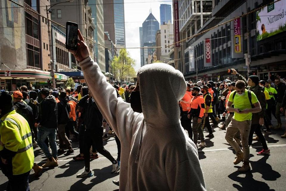 Construction workers march through the streets in Melbourne on Tuesday  (Getty Images)