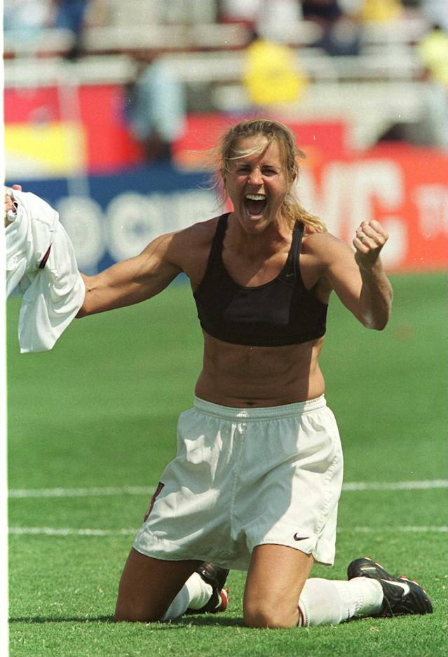 USA's Brandi Chastain rips off her shirt in celebration at the end of the 1999 World Cup final. (Photo by Jon Buckle/EMPICS via Getty Images)