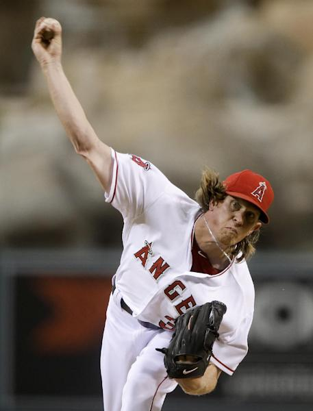 Los Angeles Angels starting pitcher Jered Weaver throws against the Boston Red Sox during the first inning of a baseball in Anaheim, Calif., Tuesday, Aug. 29, 2012. (AP Photo/Chris Carlson)