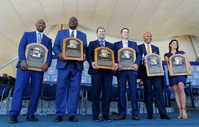 Inductees (from left) Harold Baines, Lee Smith, Edgar Martinez, Mike Mussina, Mariano Rivera and Brandy Halladay, wife the late Roy Halladay, pose with their plaques during the Baseball Hall of Fame induction ceremony at Clark Sports Center on July 21, 2019 in Cooperstown, New York. (AFP Photo/Jim McIsaac)