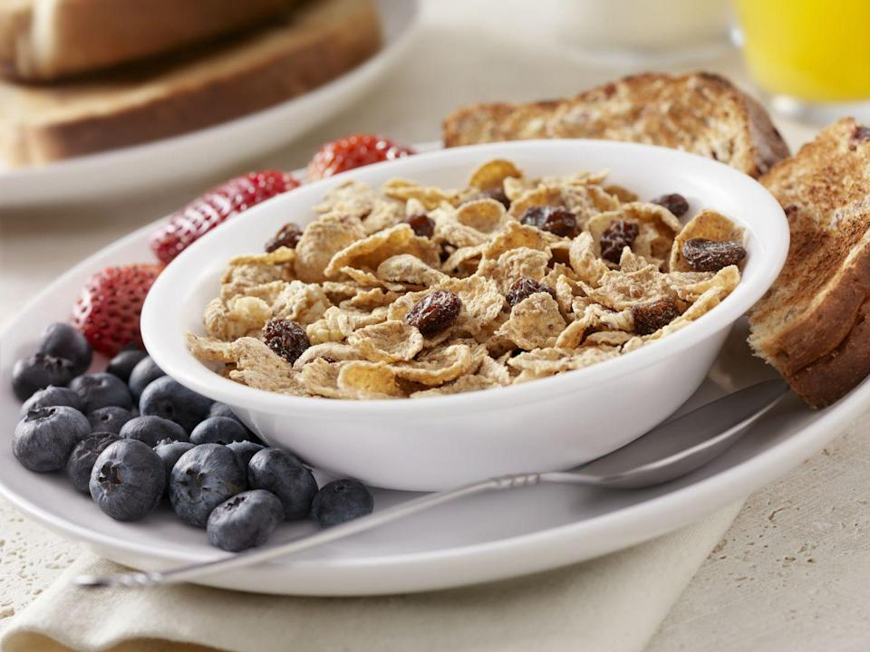 """<p>The whole grains in bran flakes keep your heart in tip-top shape by <a href=""""https://www.womansday.com/health-fitness/nutrition/advice/a4905/5-foods-that-fight-inflammation-107897/"""" rel=""""nofollow noopener"""" target=""""_blank"""" data-ylk=""""slk:reducing inflammation"""" class=""""link rapid-noclick-resp"""">reducing inflammation</a> and triglycerides, <a href=""""https://www.healthline.com/nutrition/wheat-bran"""" rel=""""nofollow noopener"""" target=""""_blank"""" data-ylk=""""slk:Healthline reports"""" class=""""link rapid-noclick-resp"""">Healthline reports</a>.</p><p><strong>Recipe to try:</strong> <a href=""""https://www.womansday.com/food-recipes/food-drinks/recipes/a12239/pumpkin-bran-muffins-recipe-wdy1013/"""" rel=""""nofollow noopener"""" target=""""_blank"""" data-ylk=""""slk:Pumpkin Bran Muffins"""" class=""""link rapid-noclick-resp"""">Pumpkin Bran Muffins</a></p>"""