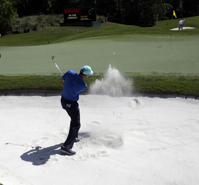 Matt Kuchar hits from the sand onto the eighth green during a practice round for The Players championship golf tournament at TPC Sawgrass in Ponte Vedra Beach, Fla., Wednesday, May 7, 2014. (AP Photo/Gerald Herbert)