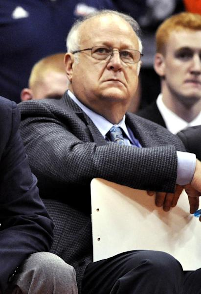 FILE - This Nov. 14, 2011 file photo shows Syracuse basketball assistant coach Bernie Fine watching a college basketball game against Manhattan in the NIT Season Tip-Off in Syracuse, N.Y. Federal authorities have dropped their investigation into sexual abuse claims that cost Fine his job, threw a top-ranked team into turmoil and threatened the career of Hall of Fame coach Jim Boeheim. After a probe spanning nearly a year, U.S. Attorney Richard Hartunian said Friday, Nov. 9, 2012 there was no evidence to support claims that Fine had molested a boy in 2002 in a Pittsburgh hotel room. (AP Photo/Kevin Rivoli, File)