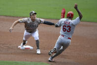 San Diego Padres second baseman Ha-Seong Kim (7) tags St. Louis Cardinals shortstop Edmundo Sosa (63) out as he goes into second base during the second inning of a baseball game Sunday, May 16, 2021, in San Diego. (AP Photo/Denis Poroy)