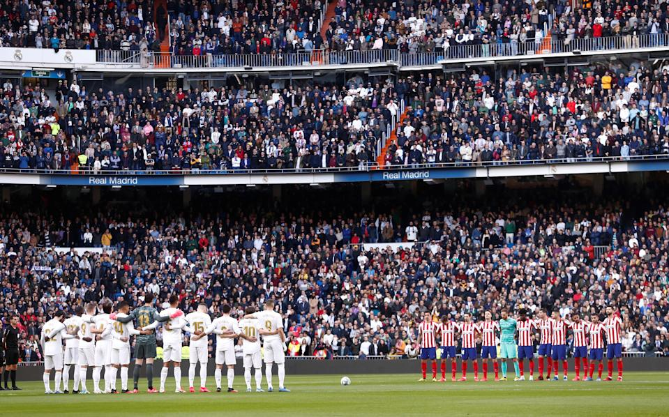 Real Madrid and Atletico Madrid stand at the center circle during a moment of silence in honor of Kobe Bryant. (REUTERS/Juan Medina)