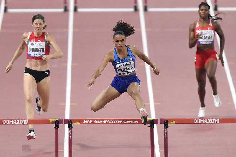 File-This Oct. 2, 2019, file photo shows Sydney McLaughlin of the United States, center, Lea Sprunger of Switzerland, left, and Aminat Jamal of Bahrain, right, competing in the women's 400 meter hurdles semifinal at the World Athletics Championships in Doha, Qatar. The 20-year-old from New Jersey finished second to Dalilah Muhammad at the world championships. Muhammad set a new world record in Qatar (52.16 seconds), with McLaughlin right on her heels. That record may keeping going lower and lower. (AP Photo/Martin Meissner, File)