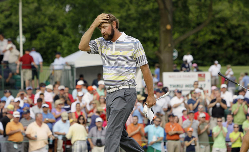 Lucas Glover reacts after winning the Wells Fargo Championship golf tournament in a sudden death playoff with Jonathan Byrd at Quail Hollow Club in Charlotte, N.C., Sunday, May 8, 2011. (AP Photo/Gerry Broome)