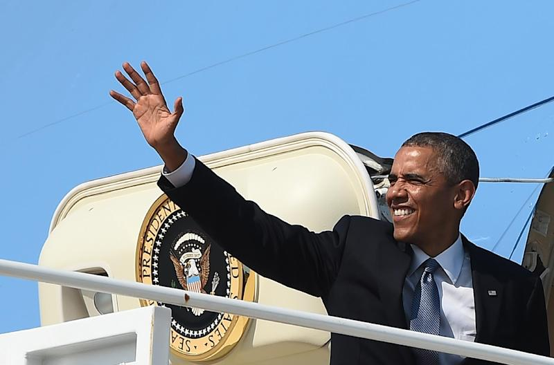 US President Barack Obama waves before boarding Air Force One on July 8, 2014 at Andrews Air Force Base in Maryland