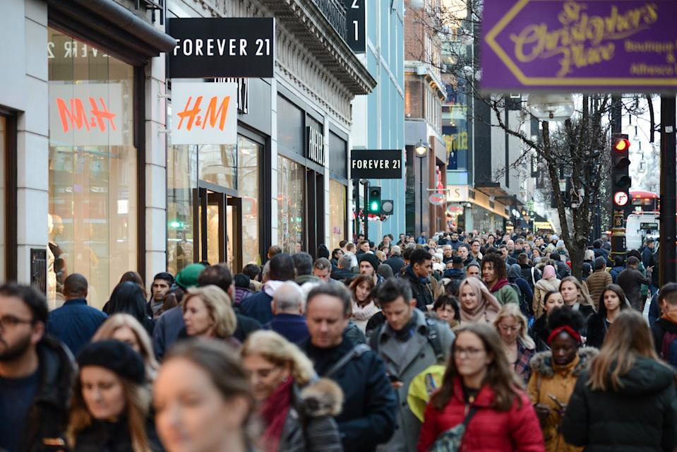 With four days to go until Christmas, shoppers are seen on Oxford Street in London,UK on December 21,2018. According to retail analysts Springboard, today is expected to be the busiest shopping day of the year so far, with more than a fifth more shoppers visiting high streets, retail parks and shopping centres than on a typical day.(Photo by Claire Doherty/Sipa USA)