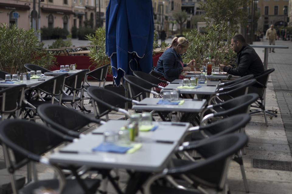 Diners eat lunch before the closure of restaurants and bars, in Marseille, southern France, Sunday Sept. 27, 2020. As restaurants and bars in Marseille prepared Sunday to shut down for a week as part of scattered new French virus restrictions, Health Minister Olivier Veran insisted that the country plans no fresh lockdowns. (AP Photo/Daniel Cole)