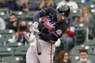 Atlanta Braves Freddie Freeman hits a solo home run against the Chicago Cubs during the first inning of a baseball game in Chicago, Sunday, April 18, 2021. (AP Photo/Nam Y. Huh)