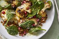 """<p>The warm roasted cauliflower gives a cozy feeling to your go-to salad and adding a hint of pumpkin pie spice makes this dish even more comforting. <br></p><p><em><a href=""""https://www.womansday.com/food-recipes/a30394185/warm-roasted-cauliflower-and-spinach-salad-recipe/"""" rel=""""nofollow noopener"""" target=""""_blank"""" data-ylk=""""slk:Get the Warm Roasted Cauliflower and Spinach Salad recipe."""" class=""""link rapid-noclick-resp"""">Get the Warm Roasted Cauliflower and Spinach Salad recipe.</a></em></p>"""