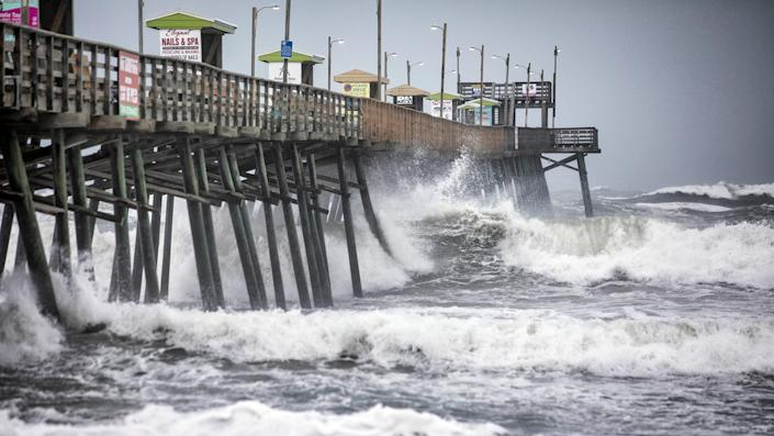 The Bogue Inlet Fishing Pier in Emerald Isle, N.C., is pounded with waves as Hurricane Dorian churns up the ocean before its arrival on Sept. 5, 2019. (Photo: Julia Wall/Raleigh News & Observer/Tribune News Service via Getty Images)