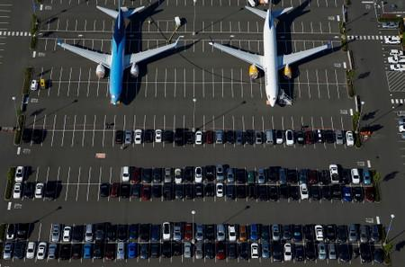 Grounded TUI Airways and Icelandair Boeing 737 MAX aircraft are seen parked in a Boeing employee parking lot in an aerial photo at Boeing Field in Seattle