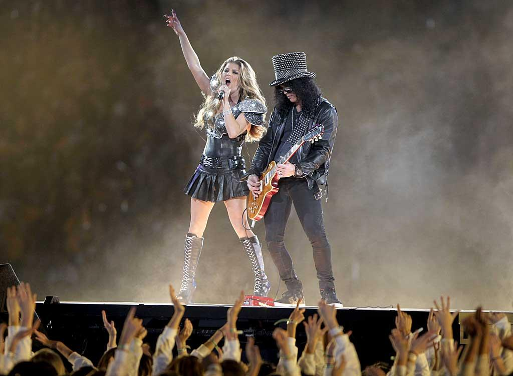 "Guns N' Roses guitarist Slash joined Fergie for a duet of ""Sweet Child O' Mine,"" where the sexy songstress attempted to channel Axl Rose. Was their rendition hot ... or not? Christopher Polk/<a href=""http://www.gettyimages.com/"" target=""new"">GettyImages.com</a> - February 6, 2011"