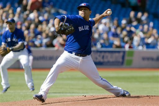 Toronto Blue Jays starting pitcher Ricky Romero works against the New York Yankees during the first inning of a baseball game in Toronto on Saturday, Sept. 29, 2012. (AP Photo/The Canadian Press, Chris Young)