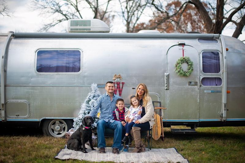 Family photo of Jesse and Caroline Wasson along with their kids Bennett and Harlynn in Springfield, MO. The family has a 1970 Airstream Overlander.