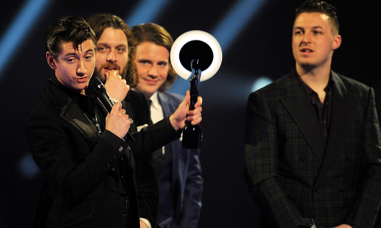 """Arctic Monkeys burst into the Brits by winning British Breakthrough Act in 2006 before going on to score Best Group in 2007, 2008 and 2014, picking up Album of the Year in those three years as well. They've given some interesting speeches along the way too, with frontman Alex Turner rounding off <a href=""""https://www.radiox.co.uk/artists/arctic-monkeys/news/alex-turner-brits-speech-i-wasnt-waffling-on-drugs/"""">his baffling 2014 speech</a> with a mic drop. (Photo by Matt Kent/WireImage)"""