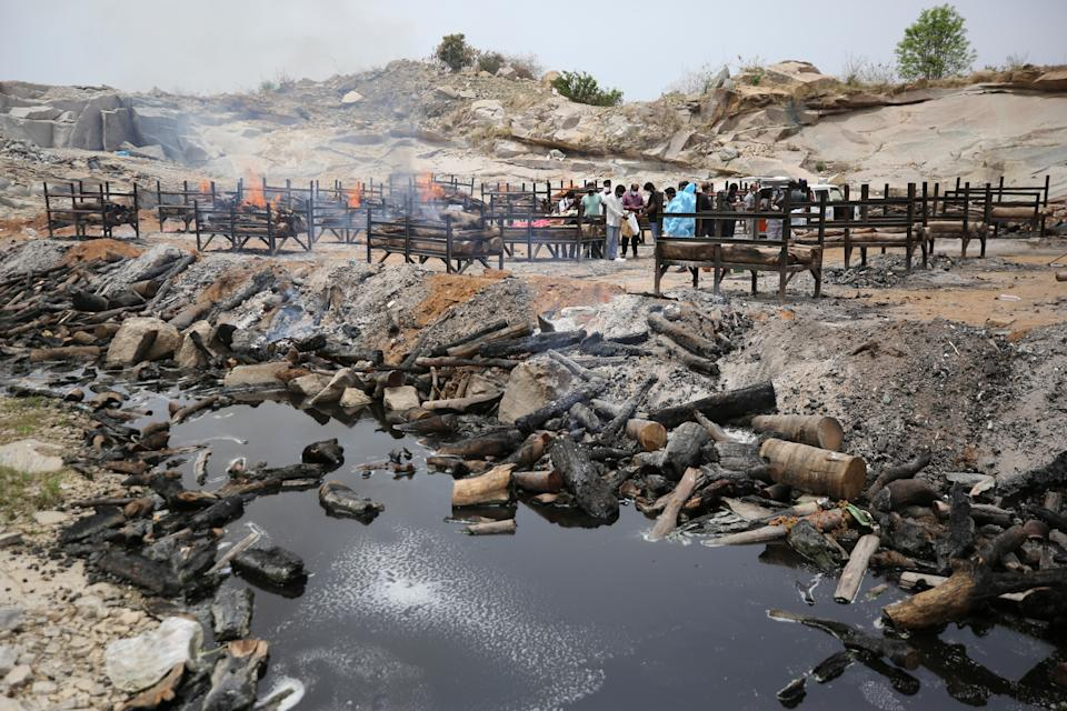 Bodies of people who died of Covid-19 are cremated at an open crematorium on the outskirts of BengaluruAP