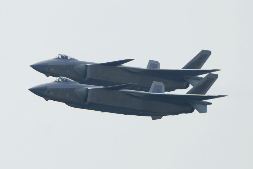 A pair of J-20 stealth fighter jets of the Chinese People's Liberation Army (PLA) Air Force perform during the 13th China International Aviation and Aerospace Exhibition, also known as Airshow China 2021, on Tuesday, Sept. 28, 2021 in Zhuhai in southern China's Guangdong province. (AP Photo/Ng Han Guan)