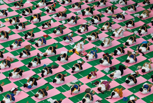 <p>People perform yoga on International Yoga Day in Chandigarh, India, June 21, 2017. (Photo: Ajay Verma/Reuters) </p>