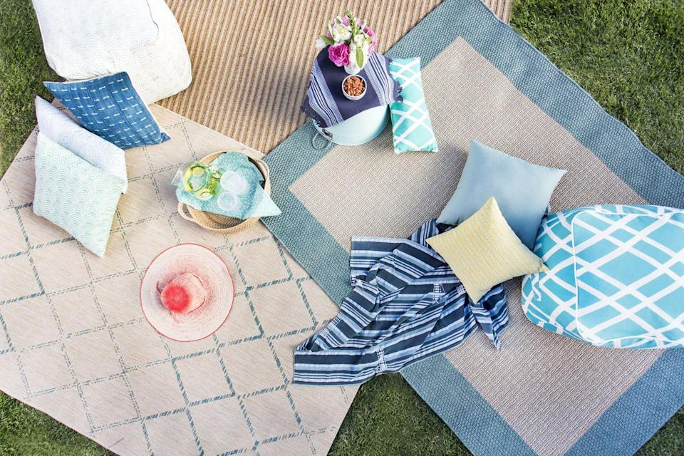 <p>Rugs, pillows and poufs (and picnic blankets, of course!) will create a casual conversation spot that plays into a laid back party vibe.<br></p>
